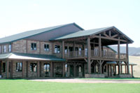 This magnificent Equestrian facility in Colorado was completed for State Senator Weins, 2000 acre Ranch.  The front of the Armor steel Building boasts a beautiful log & Rock front with a 2-story office Mezzanine that overlooks the interior arena. This facility is often used for the Children's Hospital, Buckaroo Ball and other Charity events.